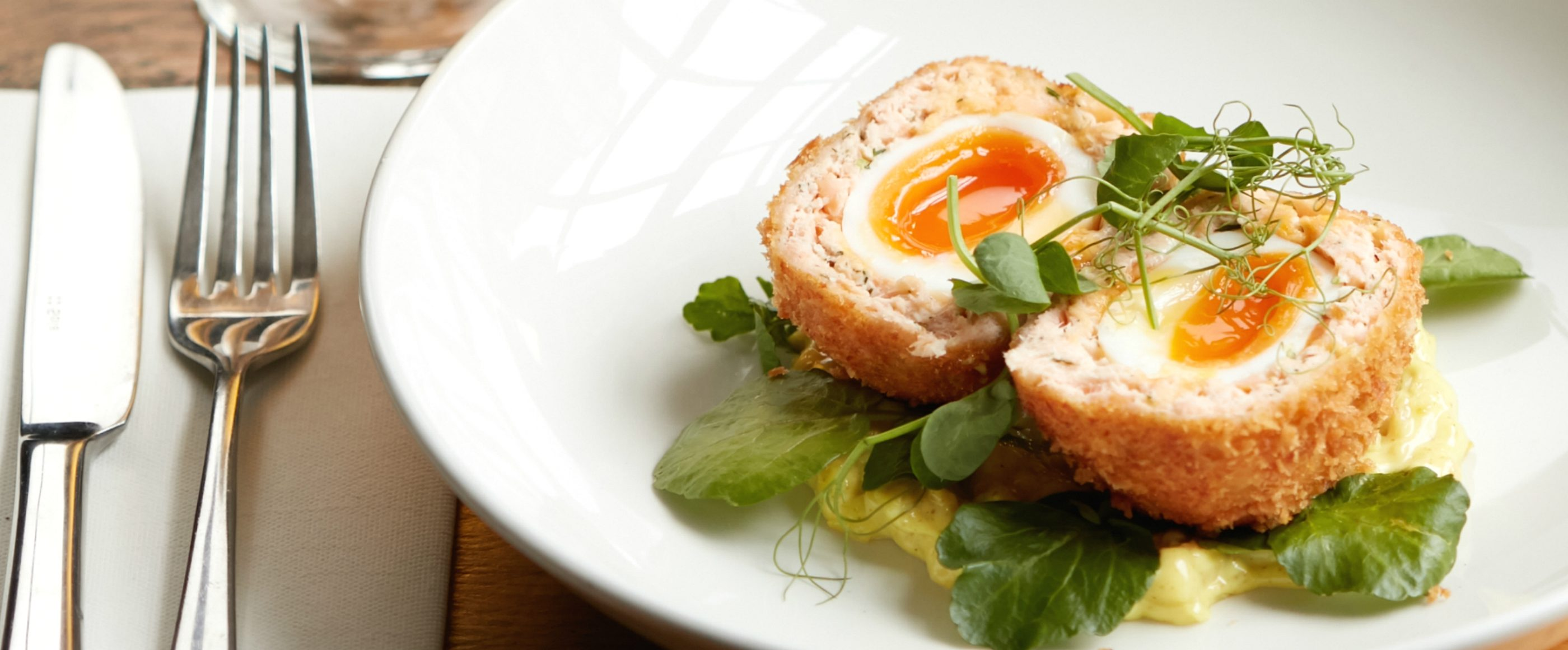 The Market Porter Hot smoked salmon scotch egg, horseradish, curried fennel mayo